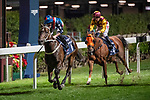 Happy Valley, Hong Kong - December 4: Flying Genius and Ryan Moore winning the Longines International Jockey' Championship Handicap First leg at Happy Valley Racecourse in Hong Kong. Michael McInally/Eclipse Sportswire/CSM