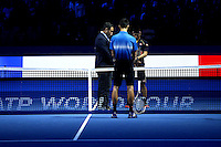 Kei Nishikori of Japan and Novak Djokovic of Serbia stand with heads bowed during the one minute's silence to remember those killed in Paris tow days before the start of the ATP World Tour Finals, The O2, London, 2015