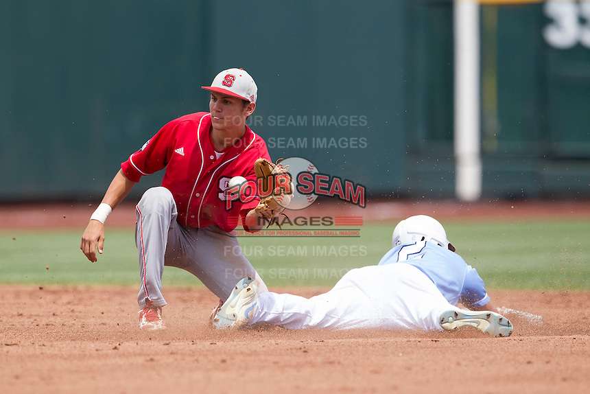 North Carolina State shortstop Trea Turner (8) waits for a throw at second base during a steal attempt in Game 3 of the 2013 Men's College World Series between the North Carolina State Wolfpack and North Carolina Tar Heels at TD Ameritrade Park on June 16, 2013 in Omaha, Nebraska. The Wolfpack defeated the Tar Heels 8-1. (Andrew Woolley/Four Seam Images)