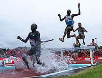 23rd May 2021; Gateshead International Stadium, Gateshead, Tyne and Wear, England; Muller Diamond League Grand Prix Athletics, Gateshead; Kibiwot lands into the water during the mens 3000m steeple chase race as Bor follows