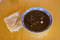 Matatlan, Oaxaca; Mexico; North America.  Day of the Dead Celebration.  Turkey in Poblano Mole Sauce, with Tortilla, for Lunch.