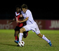 Marc Pelosi (11) of the United States fights for the ball with Christopher Nanco (11) of Canada during the finals of the CONCACAF Men's Under 17 Championship at Catherine Hall Stadium in Montego Bay, Jamaica. The United States defeated Canada, 3-0, in overtime