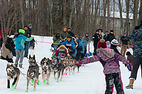 Larry Daugherty and team run past spectators on the bike/ski trail near University Lake with an Iditarider in the basket and a handler during the Anchorage, Alaska ceremonial start on Saturday, March 7 during the 2020 Iditarod race. Photo © 2020 by Ed Bennett/Bennett Images LLC