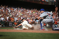 SAN FRANCISCO, CA - AUGUST 27:  Nori Aoki #23 of the San Francisco Giants is tagged out at home plate by Chicago Cubs catcher Kyle Schwarber #12 during the game at AT&T Park on Thursday, August 27, 2015 in San Francisco, California. Aoki was trying to stretch a triple into an inside-the-park home run. Photo by Brad Mangin