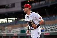 Scottsdale Scorpions third baseman Cullen Large (8), of the Toronto Blue Jays organization, jogs onto the field before an Arizona Fall League game against the Glendale Desert Dogs on September 20, 2019 at Salt River Fields at Talking Stick in Scottsdale, Arizona. Scottsdale defeated Glendale 3-2. (Zachary Lucy/Four Seam Images)
