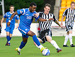 St Johnstone v St Mirren...11.09.10  .Jennison Myrie-Williams fends off Sean Lynch.Picture by Graeme Hart..Copyright Perthshire Picture Agency.Tel: 01738 623350  Mobile: 07990 594431