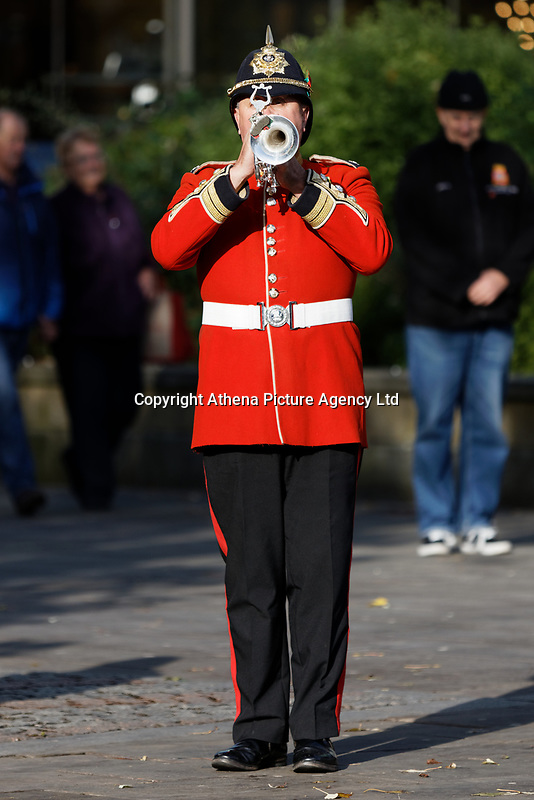Pictured: A bugler plays the last post to mark the start of the two minutes silence at Castle Square Gardens in Swansea, Wales, UK. Monday 11 November 2019<br /> Re: Armistice Day, a service to commemorate those who lost their lives in conflict has been held at Castle Square Gardens in Swansea, Wales, UK.