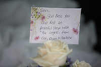 Pictured:  Flowers and tributes for baby Sion at Thornhill Cemetery, Cardiff, Wales, UK. Tuesday 28 June 2016<br /> Re: The funeral of Sion, the baby boy found dead in the River Taff in Cardiff has taken place<br /> Generous locals raised nearly £1,400 for the memorial after reading about plans to hold a fitting ceremony for the newborn baby whose body was discovered in Cardiff a year ago.<br /> The funeral took place at the Briwnant Chapel at Thornhill Crematorium, Cardiff. Members of the public are invited to be among the congregation.
