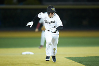 D.J. Poteet (4) of the Wake Forest Demon Deacons takes off for third base against the Florida State Seminoles at David F. Couch Ballpark on March 9, 2018 in  Winston-Salem, North Carolina.  The Seminoles defeated the Demon Deacons 7-3.  (Brian Westerholt/Four Seam Images)