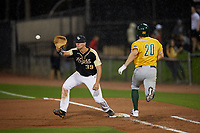 UCF Knights first baseman Connor Allen (39) stretches for a throw as Eddie Sweeney (20) runs through the bag during a game against the Siena Saints on February 14, 2020 at John Euliano Park in Orlando, Florida.  UCF defeated Siena 2-1.  (Mike Janes/Four Seam Images)