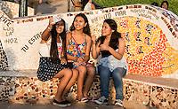 Peru, Lima, Miraflores.  Three Young Women Taking a Selfie at Love Park (Parque del Amor).