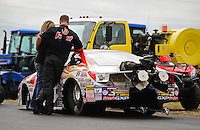 Sept. 18, 2011; Concord, NC, USA: NHRA pro stock driver Jason Line is consoled by Cindy Line after losing in the final round of the O'Reilly Auto Parts Nationals at zMax Dragway. Mandatory Credit: Mark J. Rebilas-