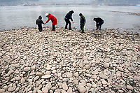 CHINA. Sichuan Province. Chongqing. A family on the banks of the Yangtze which is at its lowest for 150 years as a result of a nationwide drought. Chongqing is a city of over 3,000,000 people, famed for being the capital of China between 1938 and 1946 during World War II. It is situated on the banks of the Yangtze river, China's longest river and the third longest in the world. Originating in Tibet, the river flows for 3,964 miles (6,380km) through central China into the East China Sea at Shanghai.  2008