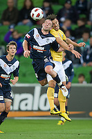MELBOURNE, AUSTRALIA - NOVEMBER 18: Leigh Broxham of the Victory heads the ball during the round 14 A-League match between the Melbourne Victory and Central Coast Mariners at AAMI Park on November 18, 2010 in Melbourne, Australia (Photo by Sydney Low / Asterisk Images)