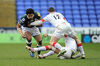 Chris Hala'ufia of London Irish drives through Duncan Taylor (centre) and Ernst Joubert of Saracens during the Aviva Premiership match between London Irish and Saracens at the Madejski Stadium on Saturday 9th February 2013 (Photo by Rob Munro)
