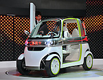 November 30, 2011, Tokyo, Japan - Daihatsu exhibits Pico during a press preview of the Tokyo Motor Show on Wednesday, November 30, 2011. Developed as a model offering the appeal that only a compact car can provide to accommodate social and environmental changes such as the aging population, regional locations and delivery, the two-seater electric vehicle represents a new category of vehicle positioned between light automobiles and motorized bicycles...The Tokyo Motor Show opened to the press Wednesday as Japanese automakers unveiled a bevy of electric cars and other green vehicles at a much smaller venue in central Tokyo, to which the show moved from the nations largest exhibition hall in neighboring Chiba prefecture after 24 years. A total of 176 brands from 13 countries and regions participated in the show. The number of foreign automakers has increased to 24 from previous nine. Out of 398 models, 52 will be shown for the very first time. An estimated 800,000 visitors are expected to attend the week-long exhibition, compared with 1.5 million in 2005, according to the organizers.(Photo by Natsuki Sakai/AFLO) [3615] -mis-..
