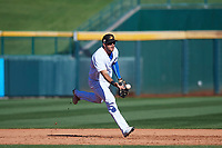 Mesa Solar Sox second baseman David Bote (15), of the Chicago Cubs organization, flips a ball to first base during an Arizona Fall League game against the Glendale Desert Dogs on October 28, 2017 at Sloan Park in Mesa, Arizona. The Solar Sox defeated the Desert Dogs 9-6. (Zachary Lucy/Four Seam Images)