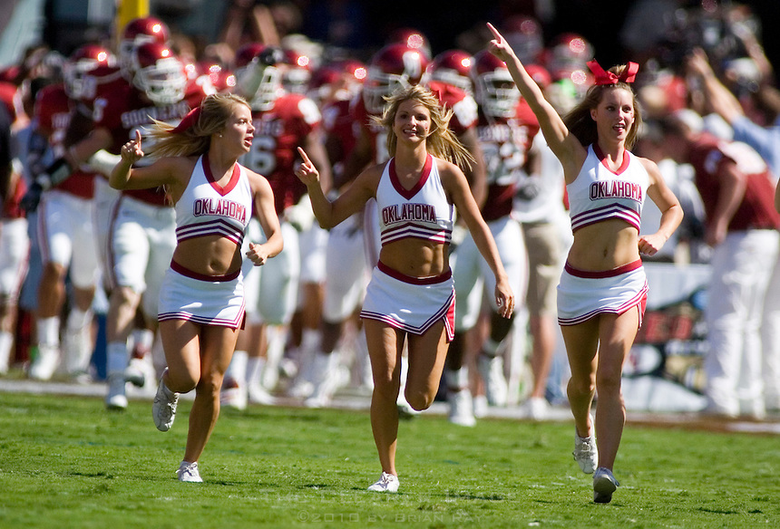 07 October 2006: University of Oklahoma cheerleaders lead the Sooner football team onto the field before their game against the University of Texas Longhorns at the Cotton Bowl in Dallas, TX.