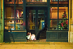 """© Joel Goodman - 07973 332324 . 16/12/2017. Manchester, UK. A man reclines in a doorway on Deansgate . Revellers out in Manchester City Centre overnight during """" Mad Friday """" , named for historically being one of the busiest nights of the year for the emergency services in the UK . Photo credit : Joel Goodman"""