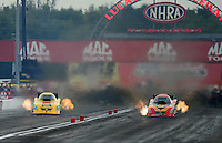 Aug. 31, 2012; Claremont, IN, USA: NHRA funny car driver Jom Head (right) races alongside Bob Bode during qualifying for the US Nationals at Lucas Oil Raceway. Mandatory Credit: Mark Rebilas-