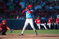 Spokane Indians designated hitter Sherten Apostel (38) at bat in front of catcher Yorman Rodriguez (13) during a Northwest League game against the Vancouver Canadians at Avista Stadium on September 2, 2018 in Spokane, Washington. The Spokane Indians defeated the Vancouver Canadians by a score of 3-1. (Zachary Lucy/Four Seam Images)