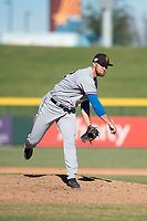 Surprise Saguaros relief pitcher Joe Kuzia (52), of the Texas Rangers organization, follows through on his delivery during an Arizona Fall League game against the Mesa Solar Sox at Sloan Park on November 1, 2018 in Mesa, Arizona. Surprise defeated Mesa 5-4 . (Zachary Lucy/Four Seam Images)