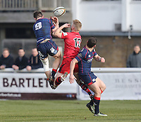 Jamie Stevenson of London Scottish and Jordan Davies of Jersey Reds challenge for the ball during the Greene King IPA Championship match between London Scottish Football Club and Jersey at Richmond Athletic Ground, Richmond, United Kingdom on 18 February 2017. Photo by David Horn / PRiME Media Images.