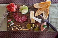 French Paradox:   duck liver mousse pâte, prosciutto, dry-cured salami, fine cheeses, cornichons, house-made dijon mustanrd, crostinis<br /> Waterfront Bistro .Cruz Bay, St. John.U.S. Virgin Islands