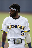 Michigan Wolverines outfielder Christian Bullock (5) in action against the Michigan State Spartans on March 22, 2021 in NCAA baseball action at Ray Fisher Stadium in Ann Arbor, Michigan. Michigan State beat the Wolverines 3-0. (Andrew Woolley/Four Seam Images)
