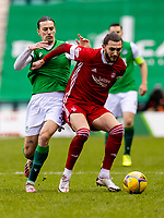 6th February 2021; Easter Road, Edinburgh, Scotland; Scottish Premiership Football, Hibernian versus Aberdeen; Jackson Irvine of Hibernian is held off by Fraser Hornby of Aberdeen compete for possession of the ball