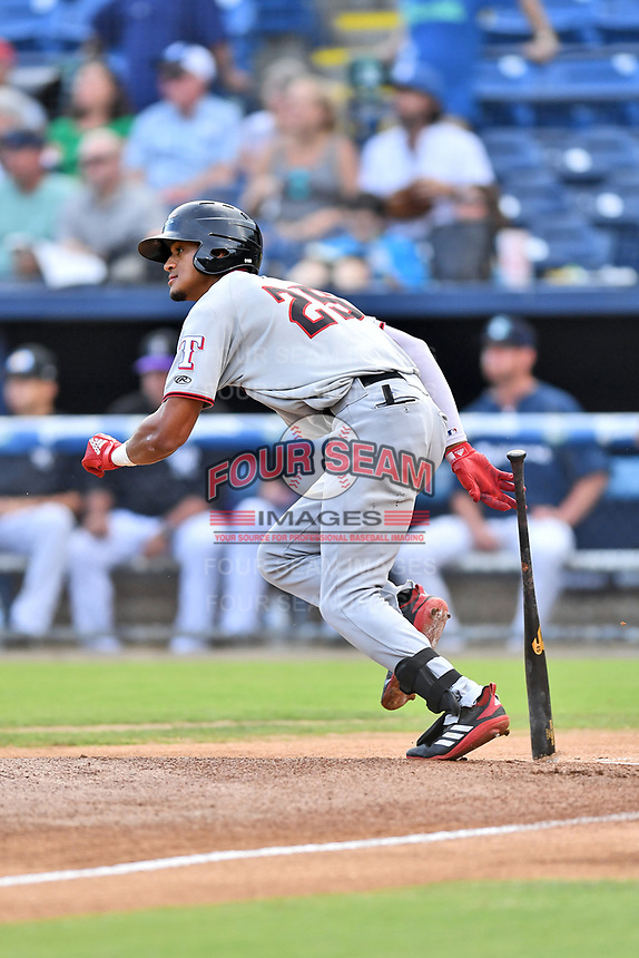 Hickory Crawdads center fielder Bubba Thompson (25) runs to first base during a game against the Asheville Tourists at McCormick Field on August 17, 2018 in Asheville, North Carolina. The Tourists defeated the Crawdads 6-3. (Tony Farlow/Four Seam Images)