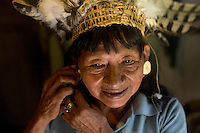 Oncayo Orango, a 70 year old Waorani (Huaroni) woman, wearing an eagle's feather head dress. The bird was hunted a few weeks earlier.