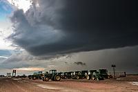 Thunderstorm above John Deere tractors in Scottsbluff, NE, June 9, 2010