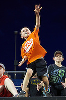 A young fans throws a tennis ball onto the field trying to get it inside a hula hoop after Batavia Muckdogs game against the Aberdeen Ironbirds on July 15, 2016 at Dwyer Stadium in Batavia, New York.  Aberdeen defeated Batavia 4-2. (Mike Janes/Four Seam Images)