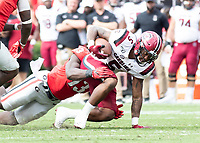 ATHENS, GA - OCTOBER 12: Rico Dowdle #5 of the South Carolina Gamecocks is tackled by Azeez Ojulari #13 of the Georgia Bulldogs during a game between University of South Carolina Gamecocks and University of Georgia Bulldogs at Sanford Stadium on October 12, 2019 in Athens, Georgia.