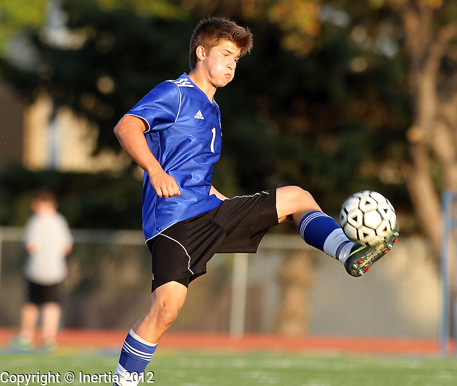 SIOUX FALLS, SD - SEPTEMBER 29: Landon Kudrna #1 from St. Thomas More controls the ball in their game against O'Gorman in the first half of their match Saturday evening at O'Gorman. (Photo by Dave Eggen/Inertia)