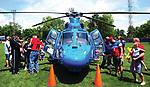 Crowds flock onto Hardman Field to check out a CareFlight helicopter that was on static display during Piqua 4th Fest at Fountain Park on Tuesday.