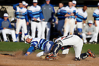 Mike Genovese #16 of the Seton Hall Pirates is out at home after being tagged by James Grandpre #23 of the Pepperdine Waves during a baseball game  at Eddy D. Field Stadium on March 8, 2013 in Malibu, California. (Larry Goren/Four Seam Images)
