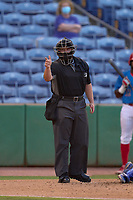 Umpire Chandler Durham calls a strike during a game between the Dunedin Blue Jays and Clearwater Threshers on May 18, 2021 at BayCare Ballpark in Clearwater, Florida.  (Mike Janes/Four Seam Images)
