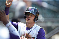 Zach Remillard (7) of the Winston-Salem Dash high fives teammates after scoring a run against the Buies Creek Astros at BB&T Ballpark on July 15, 2018 in Winston-Salem, North Carolina. The Dash defeated the Astros 6-4. (Brian Westerholt/Four Seam Images)