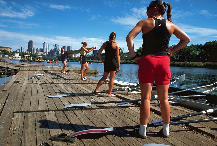 Women's rowing team preparing for exercise training