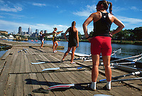 Women's rowing team preparing for exercise training