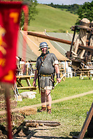 BNPS.co.uk (01202) 558833. <br /> Pic: MaxWillcock/BNPS<br /> <br /> Pictured: A roman roams the festival site. <br /> <br /> The Chalke Valley History Festival, the largest festival dedicated entirely to history in the UK, is taking place in Broadchalke near Salisbury, Wiltshire, from Wednesday 23 June - Sunday June 2021.<br /> <br /> This year, for the festival's tenth anniversary, the organisers are introducing a new Outdoor Programme that includes two outdoor stages, a revised Living History through-the-ages, and vintage fairground.