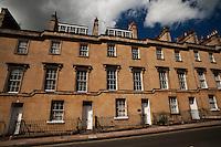 Row housing along a hilly street, Bath, England.