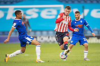 Alfie McCalmont of Oldham Athletic under pressure from Luke Gamblin  and Paris Cowan-Hall of Colchester United during Colchester United vs Oldham Athletic, Sky Bet EFL League 2 Football at the JobServe Community Stadium on 3rd October 2020