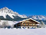 Austria, Tyrol, Kaiserwinkl, near Ellmau: Winter Scenery,  farmhouse and Wilder Kaiser Mountain