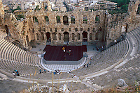 The Odeion of Herodes Atticus, a large outdoor theater on the Peripatos, the Acropolis hillside.