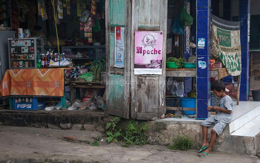 Borobudur, Java, Indonesia.  Boy and Village Street Corner.
