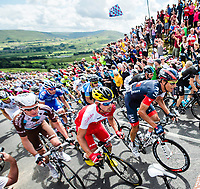 Picture by Gruber Images - 05/07/2014 - Cycling - Tour de France 2014 Grand Depart - Stage 1, Leeds to Harrogate - Yorkshire, England - Supporters cheer on riders as they climb Buttertubs. COPYRIGHT WARNING : THIS IMAGE IS RIGHTS MANAGED AND THE COPYRIGHT MAY SIT WITH A THIRD PARTY PLEASE CONTACT simon@swpix.com BEFORE DOWNLOAD AND OR USE