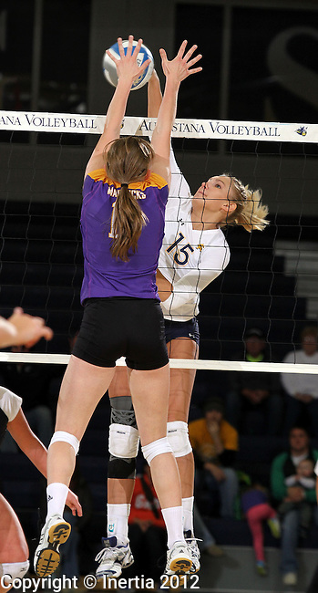 SIOUX FALLS, SD - OCTOBER 26:  Jordan Spatenka #15 from Augustana tries for a kill past Ellie Van De Steeg #10 from Minnesota State University Mankato in the first game of their match Friday night at the Elmen Center. (Photo by Dave Eggen/Inertia)